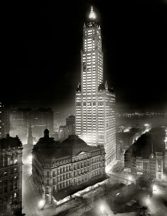 New York noir circa 1913. The Woolworth Building at night.
