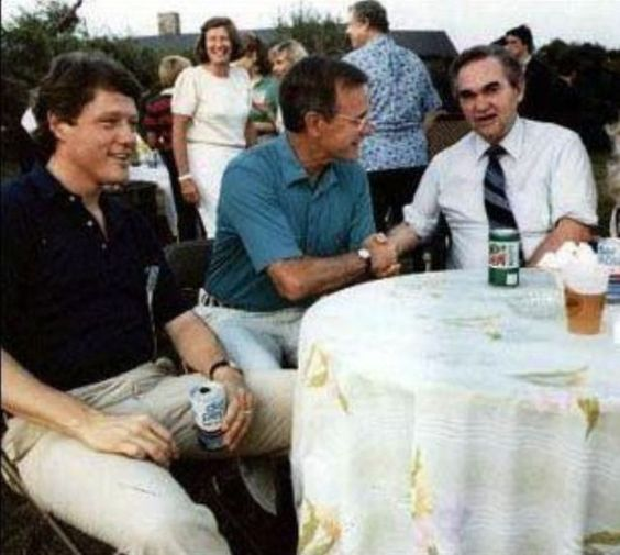 Future presidents Bill Clinton (D) and George Bush (R) with Governor George Wallace (D) at a BBQ in 1983.