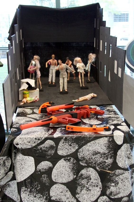 Halloween carnival games: Zombie shooting gallery - stand up zombiefied Barbies and shoot them down with a Nerf gun