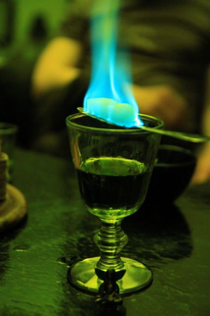 absinthe, the green fairy . oldtime muse of writers/poets/artists favored by baudelaire, rimbaud, verlaine, oscar wilde, van gogh, and so on. // (fire wasn't traditionally used though.):