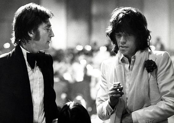 John Lennon, Mick Jagger, and May Pang attend the AFI Salute to James Cagney at the Century Plaza Hotel, Los Angeles, CA, March 13, 1974