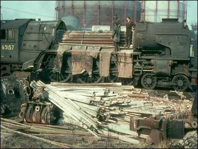 Here 60157 - Great Eastern - is being cut up for scrap at Draper's Yard in Hull, March 1965. Description from bbc.co.uk. I searched for this on bing.com/images