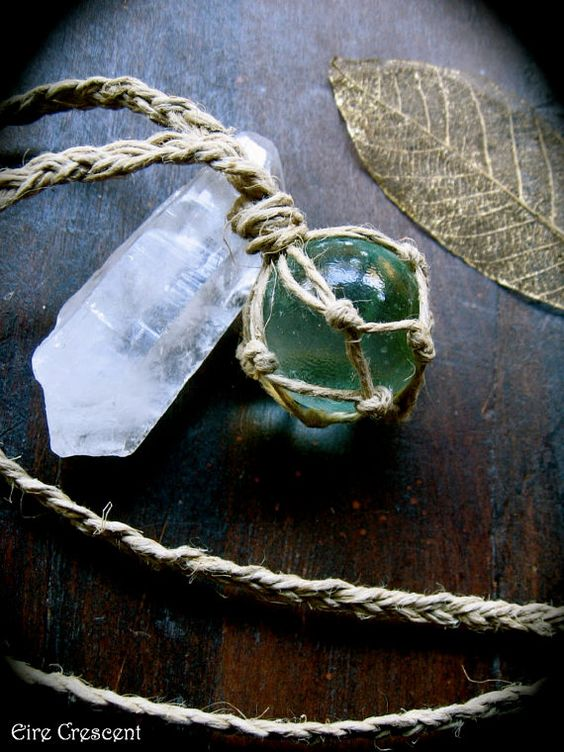 Scrying ball necklace. Green crystals align with the heart chakra and help with emotional issues.