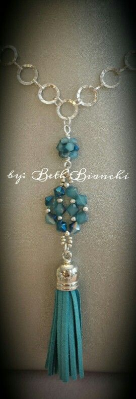 Long Tassel beaded bead necklace on a hammered ring chain.  Classic elegance.  ##tassel #tasselnecklace #classicelegance #beadingbabesofdurham #beadclasses #beadrock #takeaclass #beads