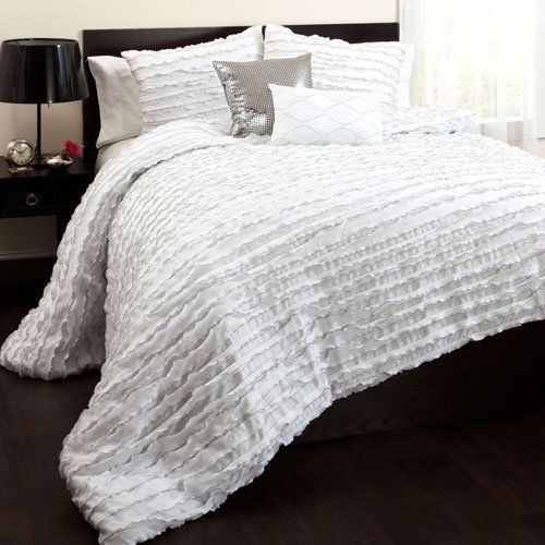"Lush Decor Modern Chic 5-Piece Comforter Set, King, White by Lush Decor. $169.98. 250 GSM Comforter. Fabric Content:100% Polyester. Comforter: 104""W x 92""D. 5-pc set includes: One comforter, two pillow shams, and two dec. pillows. Care Instructions: Comforter/shams: dry clean * Pillows: spot clean. Cascades of white ruffles highlighted by silver trim on the edges create a look that is contemporary and so stylish. With 2 shams that serve as a backdrop for the highly styl..."