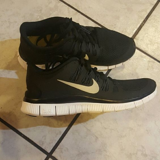 Nike Free 5.0 Used womens size 6 Black white and silver. Comes with original box. Has a small scuff on the left shoe Nike Shoes Athletic Shoes