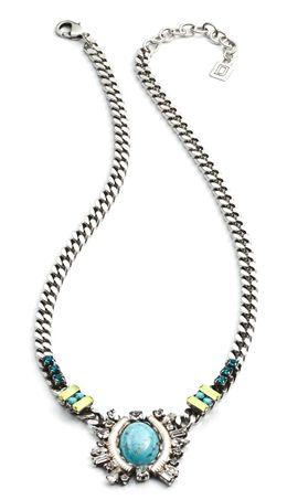 Declan by Dannijo. This delicate necklace has a thick chain that edges its way to a touch of turquoise with its large stone center piece. It also handmade with an alluring fan of Swarovski crystals in blue, lime and clear. The party of colours rests on your neck to elevate a dull outift. Handmade in New York with Swarovski elements. http://www.oxygenboutique.com/p-1256-declan-necklace.aspx
