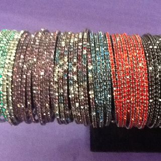 GREAT bangle in a variety of colors.  $18 each.  Grab an ARMful.