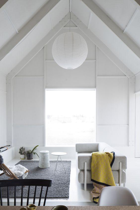 Minimalist Scandinavian living room in Linköping, Sweden. House for Mother designed by Förstberg Ling.