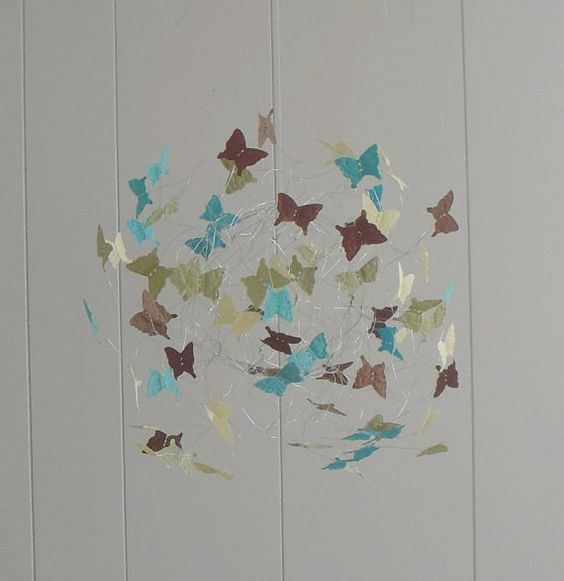 Butterfly Mobile. Really like this concept of floating circular items. Could be used outside of a baby room.