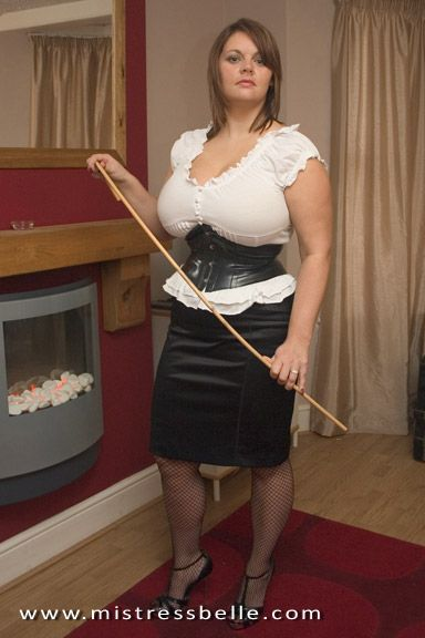 image Domme in stockings spanks straps and canes