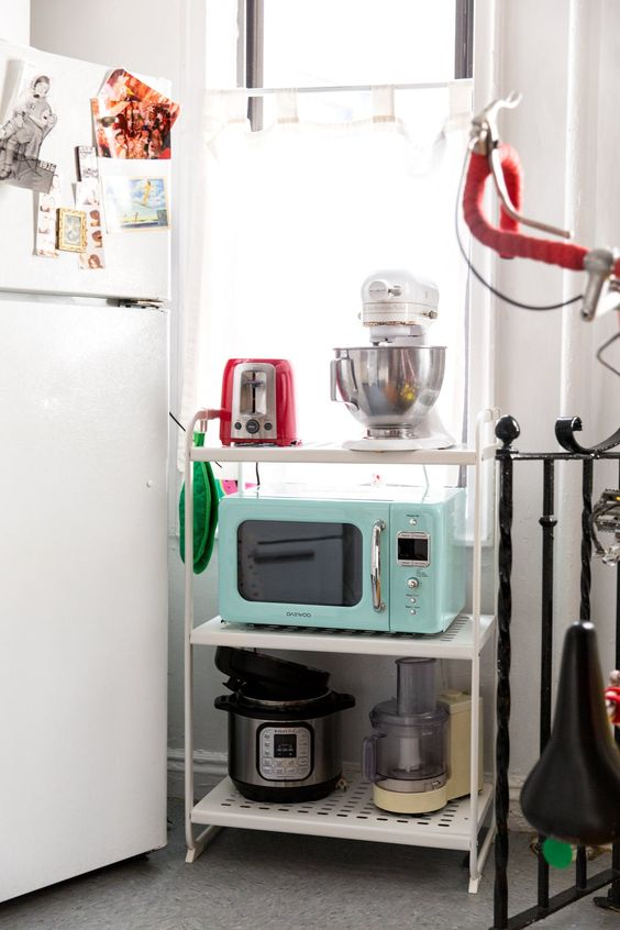 a small microwave that elevates the aesthetics of a dorm or a small apartment - todaywedate.com
