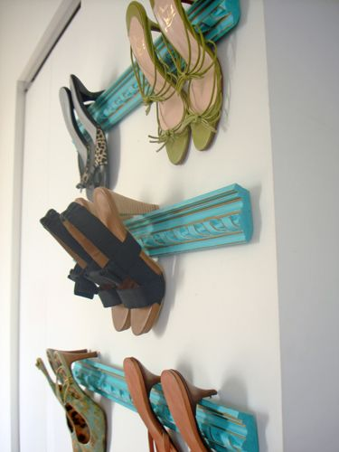 Too Cute!!!   Crown molding shoe rack! I did this. Bought one 8' piece of molding, cut it into 3 pieces, and spray painted them gold. Nailed them into the empty wall in the walk-in closet, and viola! Easy, cheaper than a fancy rack, pretty, and my shoes are off the floor. Also took no time, effort, or skill.