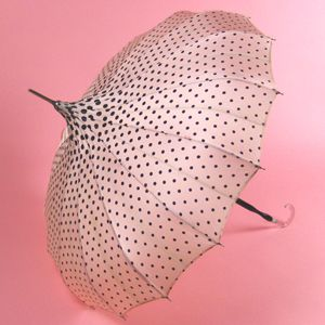 pink pagoda umbrella with black polka dots: