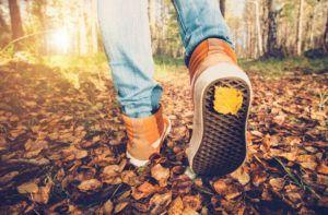Someone walking through fall leaves.