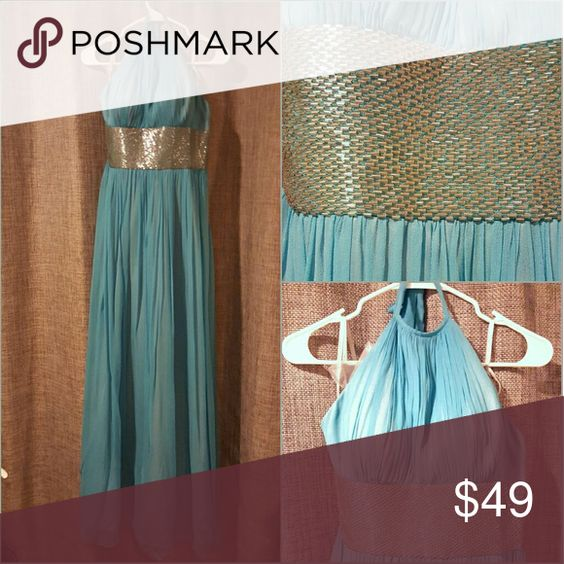 Turquoise Silk and Beaded halter gown Worn once. Side zipper. Ties at neck. Lined in silver satin with real silk overlay. Very beautiful and flowy!! Get this for cheaper than renting off a website price!! Thick lining at bust allows for braless wear. Backless. Adrianna Papell Dresses Maxi