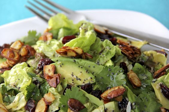 cranberry avocado salad with candied spiced almonds and sweet white balsamic vinaigrette