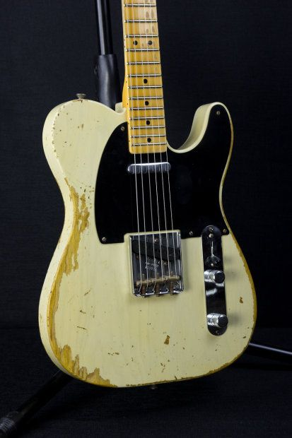 """This Fender Custom Shop '51 Nocaster Heavy Relic is in a custom Faded White Blonde Finish, with Ash Body, Lacquer Finish, Chrome Hardware, 1-Piece Maple Neck, 6105 Fretwire, 9.5"""" Radius, '52 U Neck Shape, a '51 Nocaster Neck Pickup and Broadcaster Bridge Pickup, and has modern wiring.Specifications:Serial Number: R13516Model: 51 Nocaster Heavy RelicColor: Faded White BlondeBody: AshFinish: LacquerNeck Profile: '52 Style U, .990""""Fretboard Radius: 9.5""""Neck Wood: 1 Piece Maple Neck and ..."""