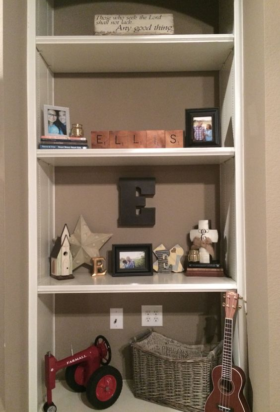 Bookcase! The best part about decorating after you're married are the monograms and letters.