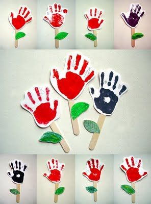 Hand prints. Would be wonderful as a gift for Grandma on Mothers Day. Maybe gluing a magnet to stick so she can put on fridge.