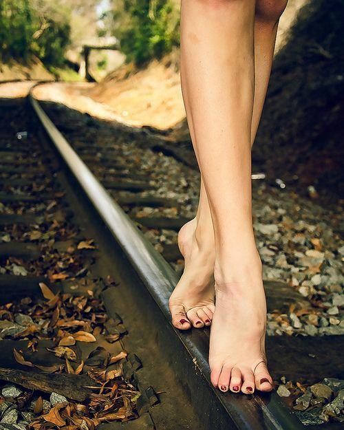 Bare feet walking on the Railway