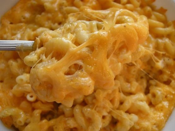 1 can creamed corn, 1 can sweet corn, 1 stick light margarine, 1 cup elbow macaroni, 1 cup velveeta. Dont drain any cans. Add salt and pepper to taste. Cook in crockpot until noodles are done. AMAZING!!: