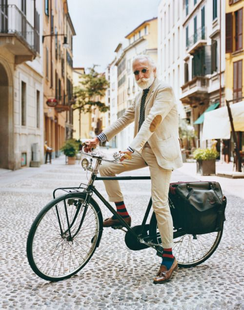 A dapper man on a bicycle!: