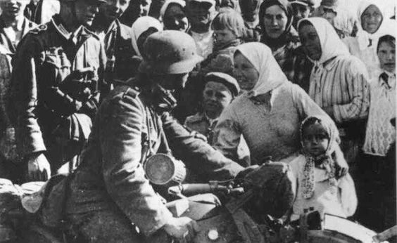 Many Ukrainians welcomed the German soldiers, hoping they were there to liberate them from Stalin's regime.: