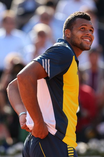 Jo-Wilfried Tsonga Jo-Wilfried Tsonga of smiles after victory in his Men's Singles quarter final match against Roger Federer of Switzerland during day ten of the French Open at Roland Garros on June 4, 2013 in Paris, France.