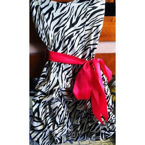 Zebra print dress w/ pink bow Great for party, birthday, homecoming... Anything! Only worn once Dresses Mini