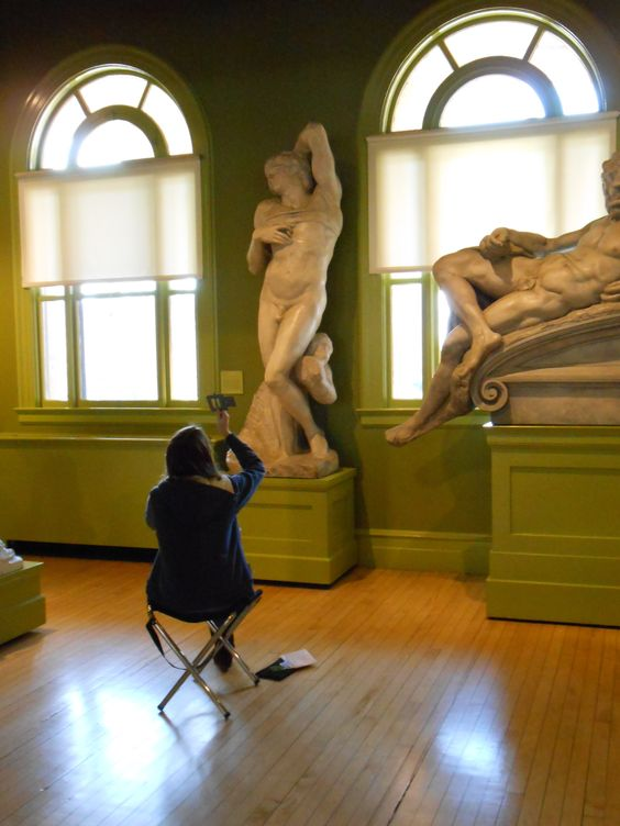 An art student from a local university sketches in the George Walter Vincent Smith Museum.