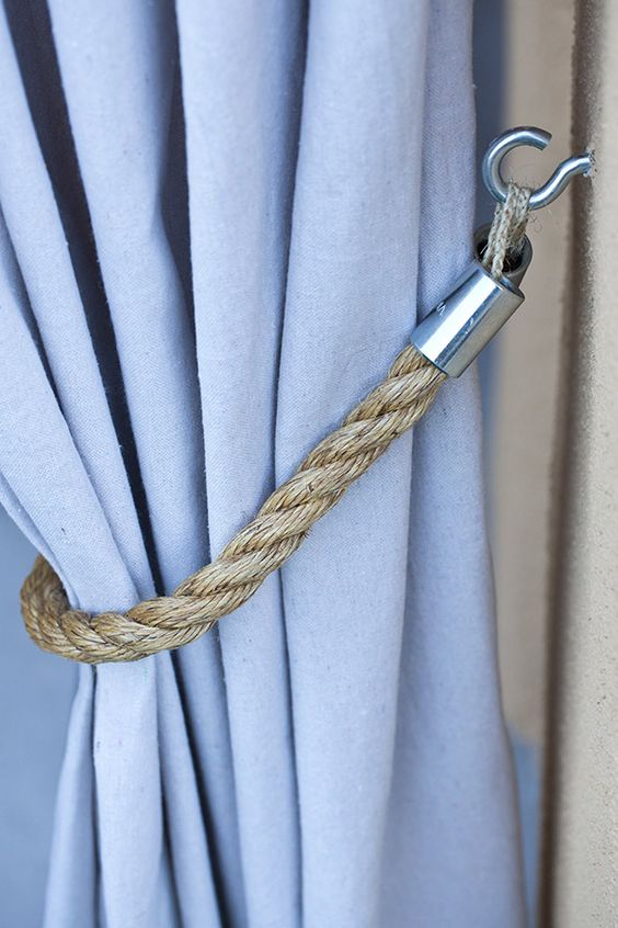What a lovely outdoor decor detail. We love this rope tie back for the outdoor curtains on a small covered patio. See the patio makeover on The Home Depot Blog.: