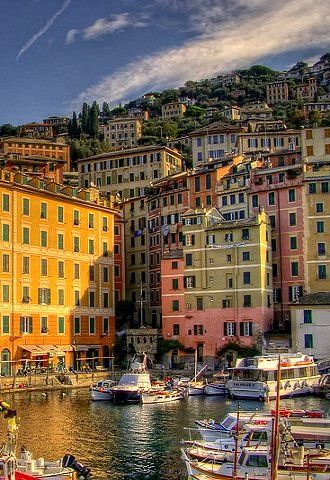 Camogli, Genoa, Italy (by fede0253 on Flickr) The houses were painted different colors so the fishermen could recognize their home from afar.