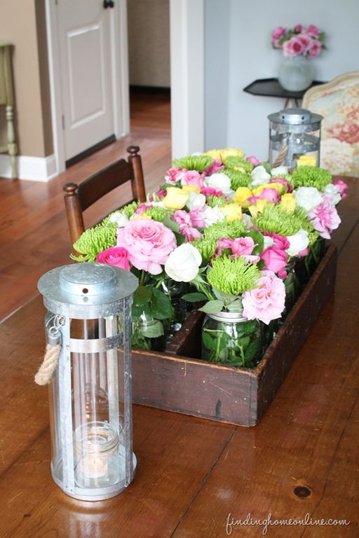 Decorating ideas the evolution of a dining room jars for Dining table centerpieces flowers