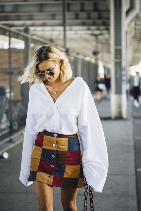 A billowy white blouse gives a modern upgrade to a vintage skirt.