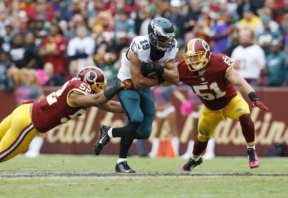 Miles Austin Kennan Robinson Will Compton:  Philadelphia Eagles wide receiver Miles Austin (19) tries to run between defenders Washington Redskins inside linebacker Keenan Robinson (52) and Washington Redskins inside linebacker Will Compton (51) during the second half of an NFL football game in Landover, Md., Sunday, Oct. 4, 2015. (AP Photo/Patrick Semansky)