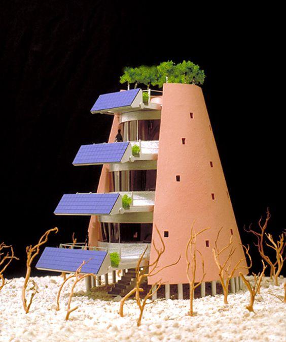 De Solar Electric Desert House is ontworpen in 1995: een grote verstelbare (aan veranderende zon hoeken huisvesten) reeks van fotovoltaïsche cellen worden op de voorzijde van multi-level exterieur dek ruimtes gemonteerd.  De structuur heeft ook een groep van bomen rond het bovendek geplant.