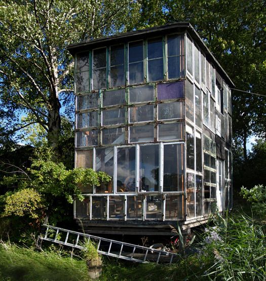 """Glass house in Freetown Christiania, Copenhagen, exemplifying modern """"architecture without architects""""."""
