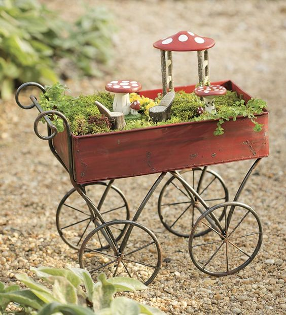 This miniature red metal push cart is a unique way to display your fairy garden or miniature garden. Fill it with moss, herbs, succulents and more, then top with a set of delightful fairy furniture.
