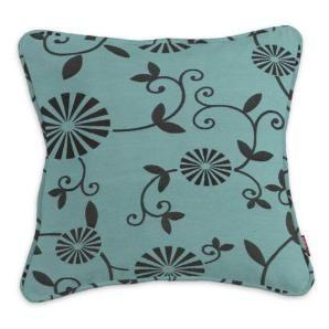 Diese Kissenhülle punktet durch den eleganten floralen Druck auf türkisem Grund.