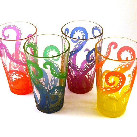 Colorful Handmade Glassware Featuring Etched & Painted Tentacles Grabbing Glasses From Below http://laughingsquid.com/colorful-handmade-beverage-glassware-featuring-etched-and-painted-tentacles-grabbing-the-glasses-from-below/ …