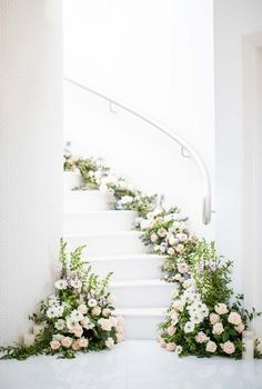 FOR THE RECEPTION    All white floral decorated staircase    NOVELA BRIDE...where the modern romantics play & plan the most stylish weddings... www.novelabride.com @novelabride #jointheclique