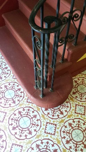 Cuban Cement tiles work their charm on this staircase landing.