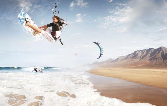 Girl kite surfing