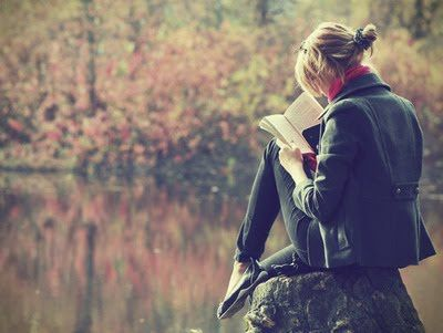 reading. on a rock. comfy scarf. colorful leaves. serene water. yes yes yes.