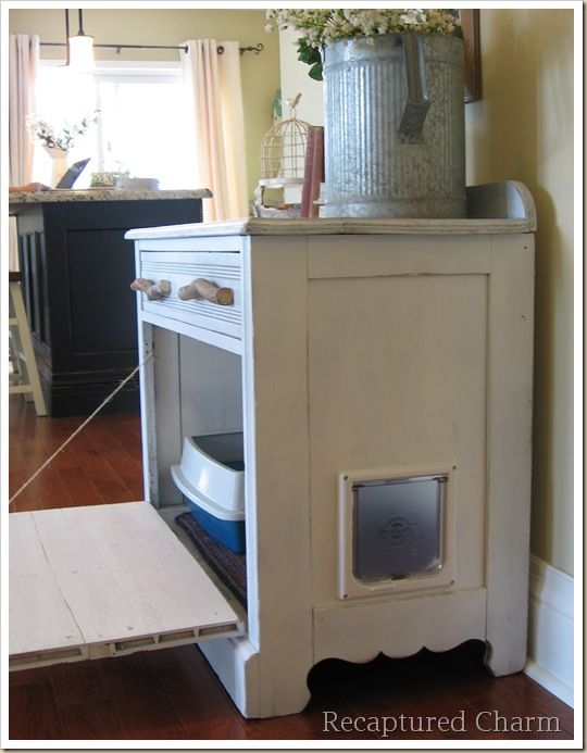 An old dresser made into a cat litter box storage area....the front of the dresser is hinged so that the box can be cleaned, but otherwise it looks like a dresser with drawers on the outside. A catdoor in the side allows kitty access.