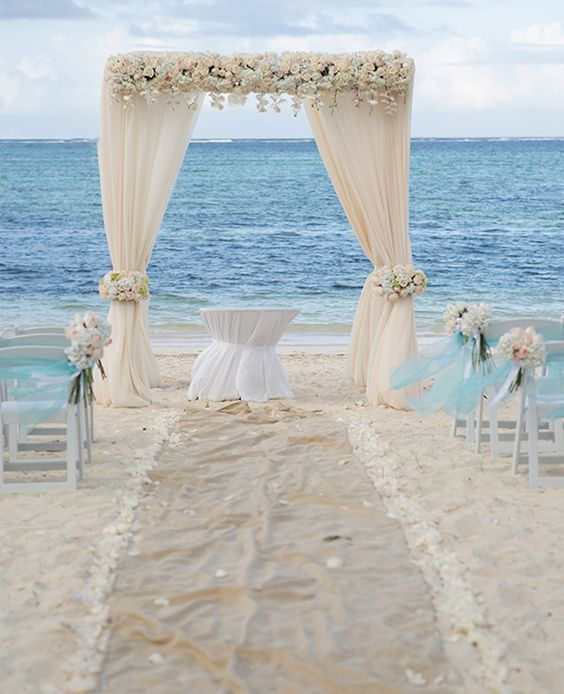Simple Wood Benches Mixed With Coral Peach Orange Flowers For A Small Beach Wedding