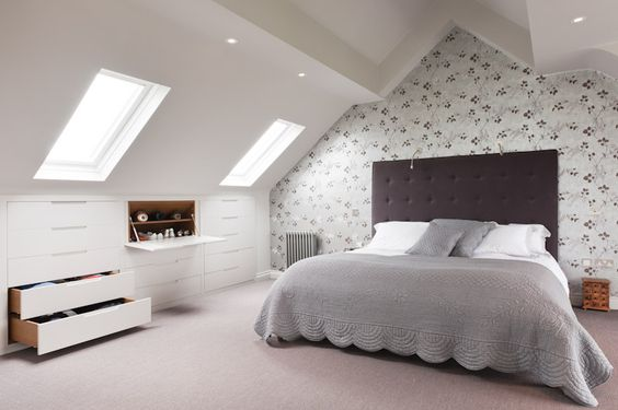 like the storage, also quite like the idea of wallpaper behind the bed …