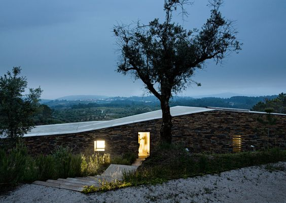 """This zigzag-shaped holiday home in Portugal features a series of stepped levels, designed by Camarim Arquitectos to evoke """"a walk in the countryside"""""""