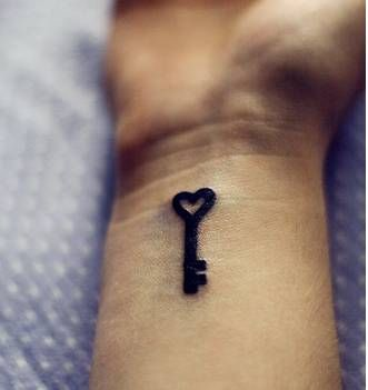 Love the placement of this key tattoo